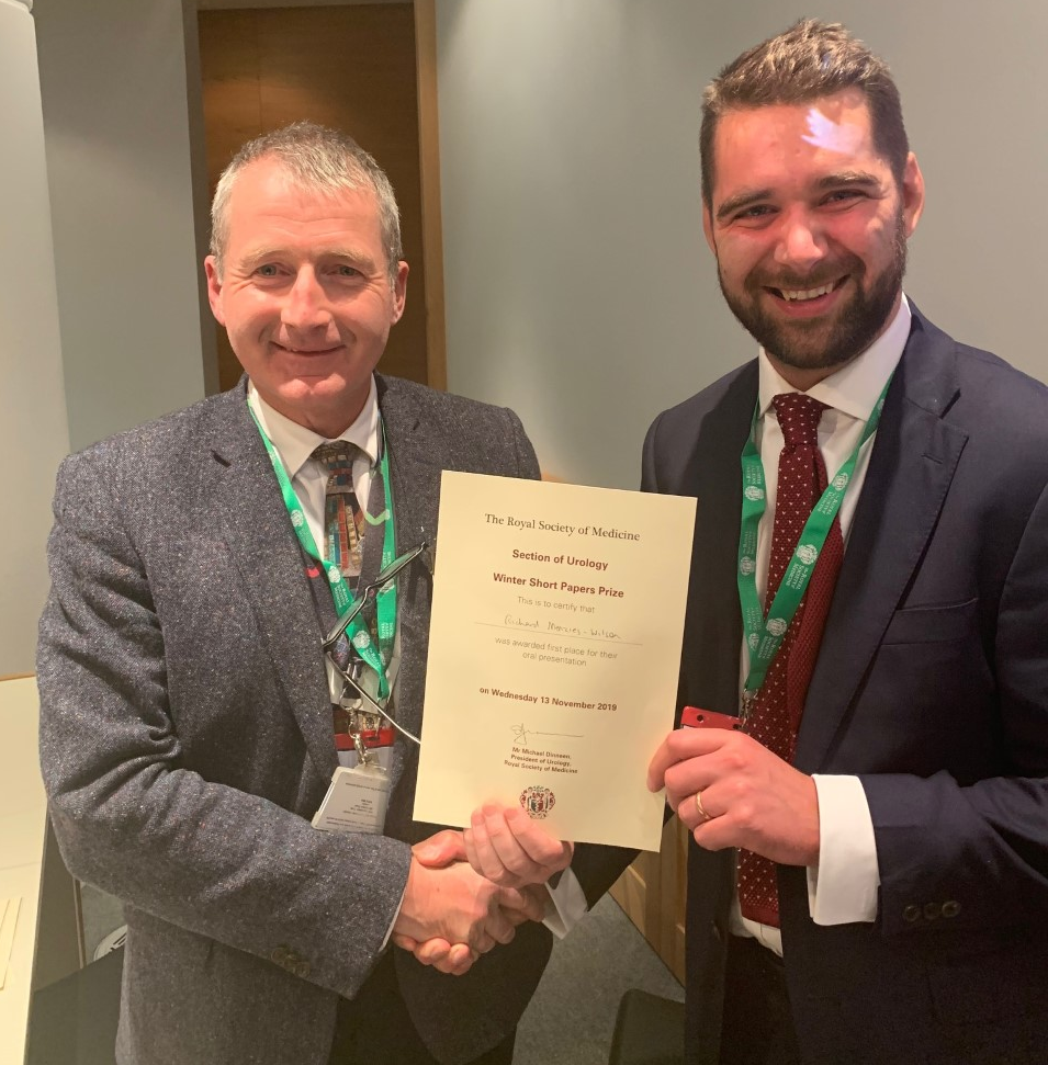 Mr Mike Dineen, President of the RSM Section of Urology presenting first prize, at the Winter Meeting on Innovation, to Mr Richard Menzies-Wilson, Clinical Research Fellow in Urology at Whipps Cross Hospital, Barts Health NHS Trust.