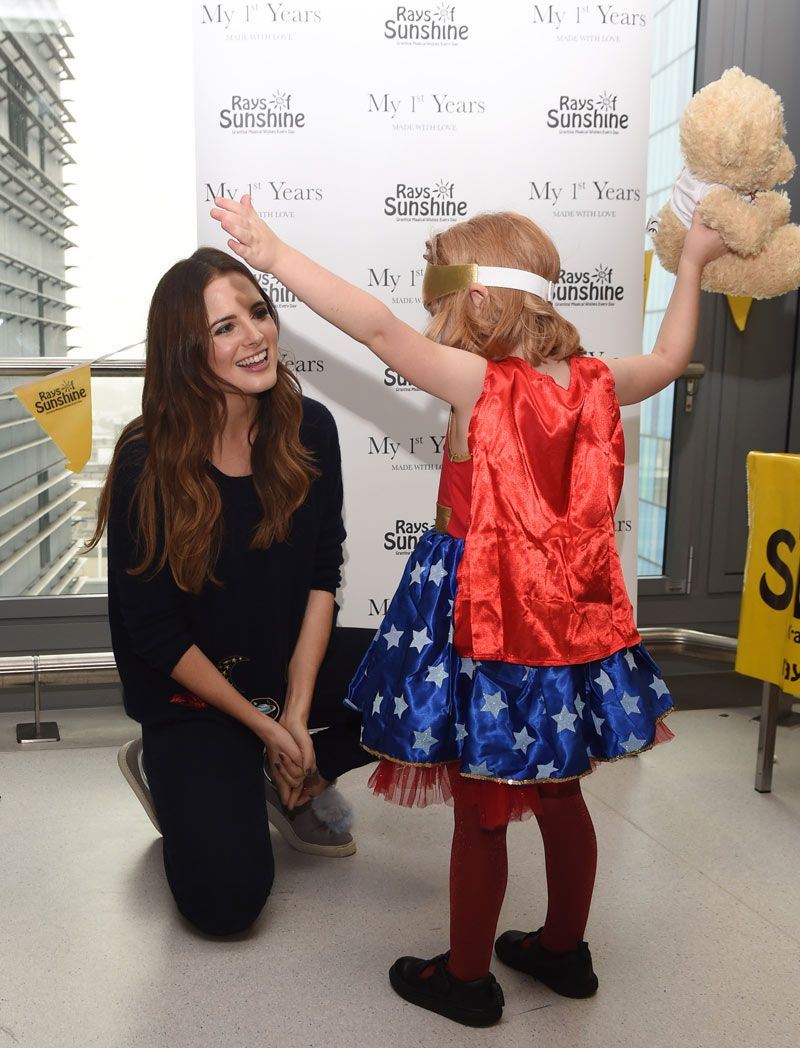 Binky Felstead is pictured with a young patient dressed as a superhero. Pictured at the Activity Day on the 26 October 2017.